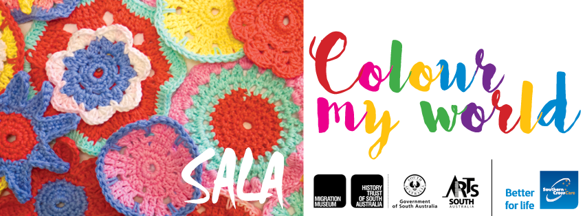 A bunch of colourful knitted flowers are on the left with the word SALA at the bottom. You can see the word 'Colour my world' and the Migration Museum, History Trust of South Australia, Arts South Australia and Southern Cross Care Better for life logo on the right.