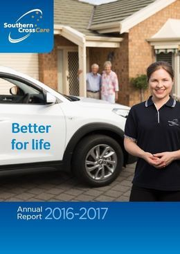 A Southern Cross Care employee is standing in front of a white car that has the words 'Better for life' written on it. An older couple can be seen standing outside their front porch.