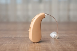 A hearing aid on a table.