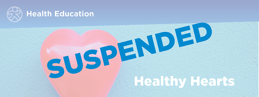 The words 'Suspended' is written in uppercase letters overlaying the text 'Healthy Hearts'.