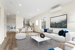 A display of Unit 29 at the Oaklands Park. The open plan living space features modern gray furnishings.